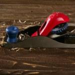 Planer carpenter hand tool wood shaving — Stock Photo