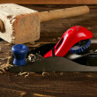 Planer carpenter hand tool wood shaving - Stock Photo