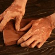 Artist man hands working red clay for handcraft — Stock Photo #5505177
