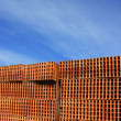 Construction bricks stacked pattern red clay — Stock Photo #5505218