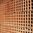 Construction bricks stacked pattern red clay — Stock Photo #5505219