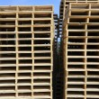 Wooden pallets stacked outdoor blue sky — Stock Photo #5505226