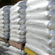 Sandbags bags white pallet sacks stacked - Stock Photo
