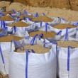 Sandbag white big bag sand sacks quarry — Stock Photo #5505239