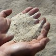Gravel sand in man hands in quarry background — Stock Photo