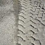 Excavator tyres footprint on quarry white sand — Stock Photo