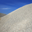 Gravel gray mound quarry stock blue sky — Stock Photo #5505298