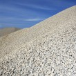 Gravel gray mound quarry stock blue sky - Stock Photo