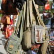 Bags hanging in market shop green khaki brown — Stock Photo
