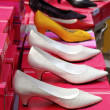 Fashion woman heel shoes in a row — Stock Photo