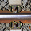Iron rusty train railway detail over dark stones — Stock Photo