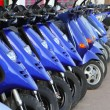 scooter mototbikes row many in rent store — Stock Photo #5505355