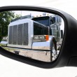 Rearview car driving mirror overtaking big truck - Stock Photo