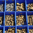 Plumbing bronze brass pieces blue boxes - Stock Photo