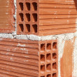 Brick corner edge red construction clay bricks — Stock Photo