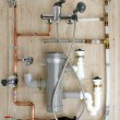 copper plumbing installation and polyethylene pvc — Stock Photo