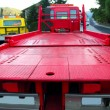 Tow car truck red rear view perspective platform — Stock Photo