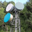 Communication tower antenna in outdoor forest - Stock Photo