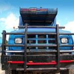 Aged grunge old truck under blue sky — Stock Photo