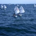 Optimist, recreation little sailboat regatta, Spain — Stock Photo #5505486