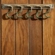 Stock Photo: Rural hanger over wooden wall, horse stables