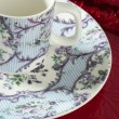 England old style tea cup and dish over red tray - Stock Photo