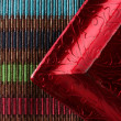 Red frame corner over multi color tablecloth — Stock Photo