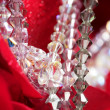 Shiny jewelry over red rose petals - Stock Photo