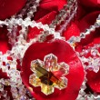 Royalty-Free Stock Photo: Shiny jewelry over red rose petals