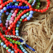 Color stones jewelry necklaces, straw background — Foto Stock