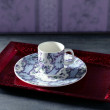 Stock Photo: Tecup victorian, red tray,wallpaper background