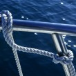 Stock Photo: Marine fender knot around boat lee