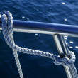 Marine fender knot around boat lee - Stockfoto