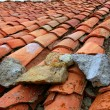 Aged old red clay arabic roof tiles - Foto Stock