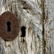 Key hole over aged gray old wood — Stock fotografie