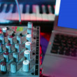 Stock Photo: Audio mixer music desk under colorful lights