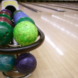 Bowling balls perspective in game center — Stock Photo