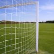 Net soccer goal football green grass field — Stock Photo #5505956