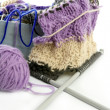 Knitting tools with wool thread balls - Stock Photo