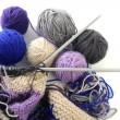 Knitting tools with wool thread balls — Stock Photo #5505986