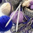 Knitting tools with wool thread balls — Stock Photo