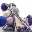 Knitting tools with wool thread balls — Stock Photo #5505991