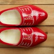 Dutch Holland red wooden shoes on wood - Stock Photo