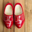 Dutch Holland red wooden shoes on wood — Stock Photo