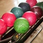 Постер, плакат: Bowling balls red green closeup row