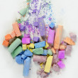 Colorful chalk broken colors mess over white — Stock Photo
