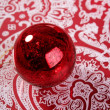 Chrsitmas red ball over indian pattern - Zdjęcie stockowe