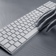 Royalty-Free Stock Photo: Computer keyboard aluminum silver hand