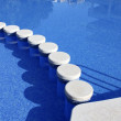 Stock Photo: Blue swimming pool round tiles way
