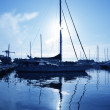 Blue marina sunset boats with water reflection - Stock Photo